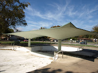 Concrete shade over a public pool in Tulsa.