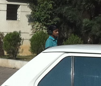 Pune India men wearing earmuffs
