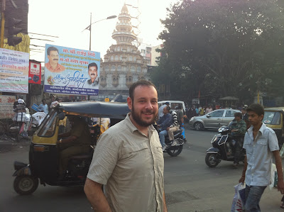 Pune India street scene temple tourist camp