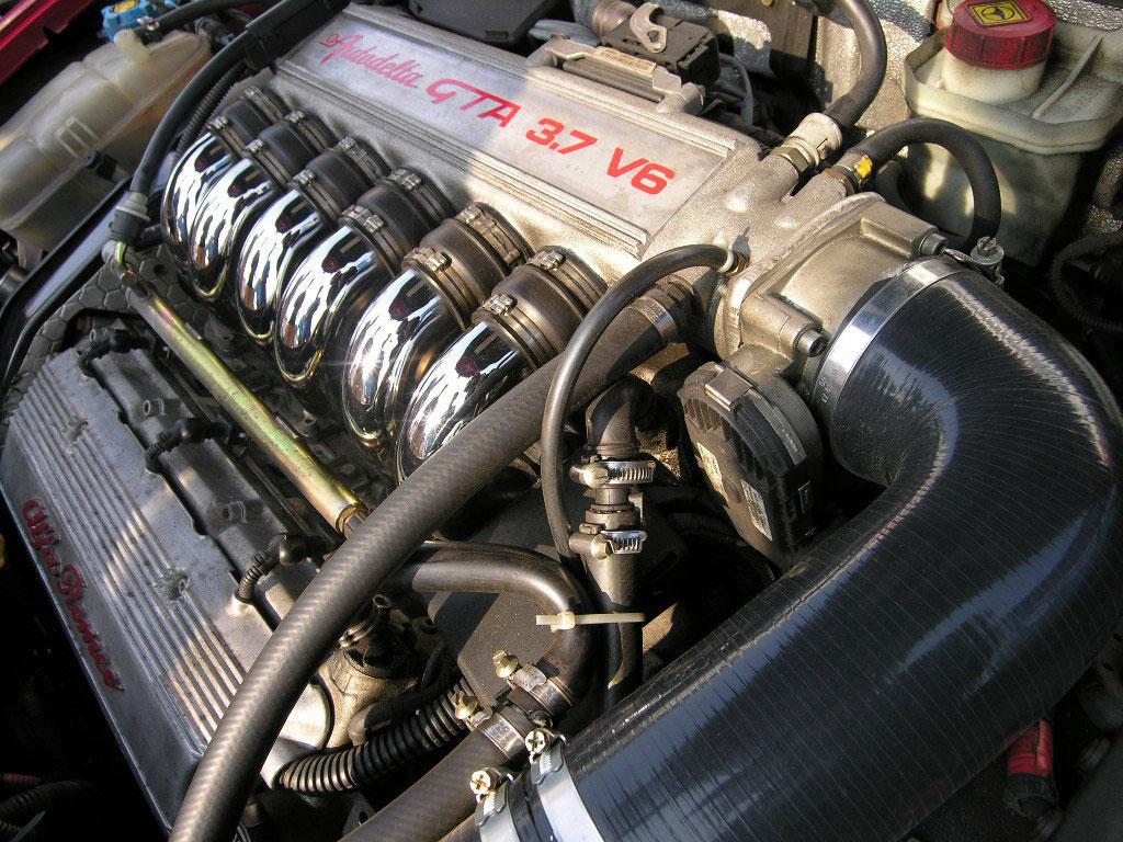 http://1.bp.blogspot.com/_sRGU_JXOz6E/TSYMZ0fppnI/AAAAAAAAA_M/aEy4GAIn7sw/s1600/alfa-romeo-autodelta-147-gta-am-37-super-engine.jpg