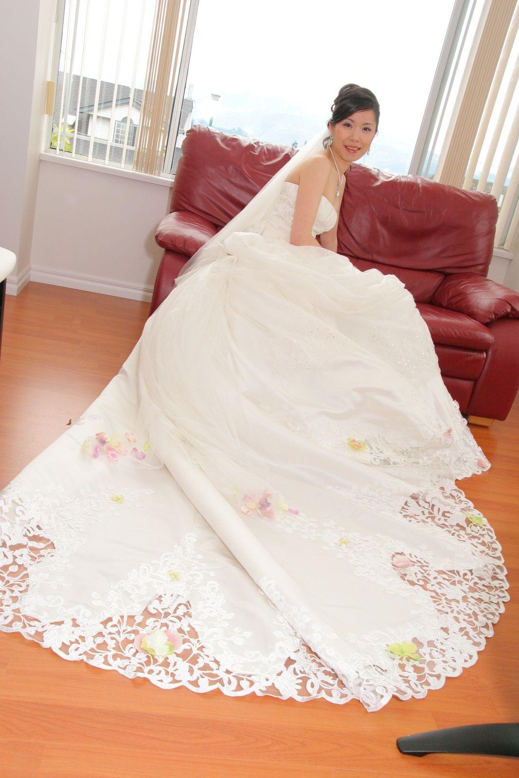 reddish background and white wedding dress.
