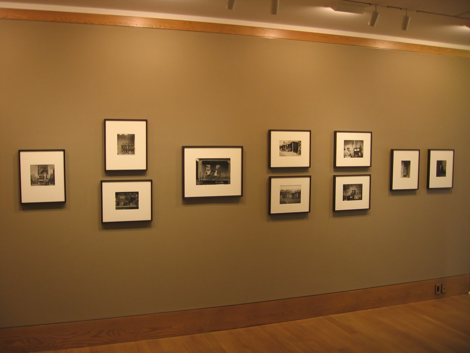 ... and hung against brown walls in the main gallery space.