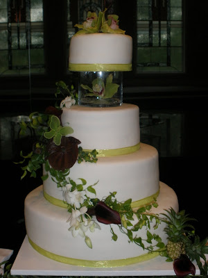 it 39 s a piece of cake cascading green and purple orchid wedding cake. Black Bedroom Furniture Sets. Home Design Ideas
