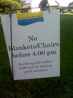 Sign: no blankets/chairs before 4:00 pm