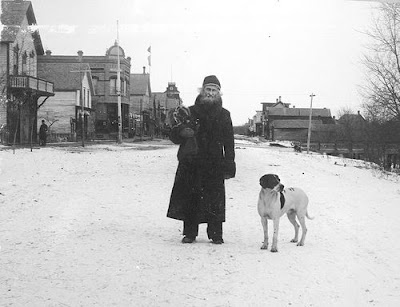 Charles Cavileer standing on downtown Pembina street, year unknown