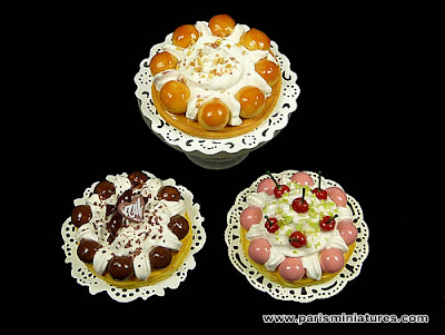 Trio of miniature Saint Honoré cakes, classic, chocolate and cherry