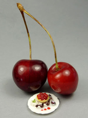 Miniature cherry tartlette dessert with real cherries
