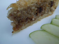 A slice of rabbit pie with granny smith apples.