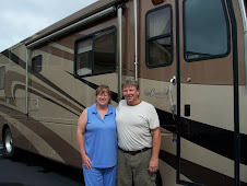Mike & Jeri w/motorhome in