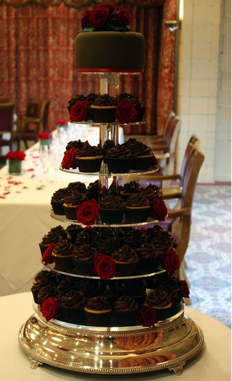 A chocolate red rose wedding cupcake tower combo Another variation of the