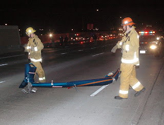 Small helicopter crashes on Los Angeles Freeway. © Photo by Mike Meadows. Click to view more...