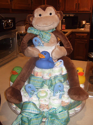 I put a diaper on my topper, just to make everyone laugh well I made myself laugh - who am I kidding! Step 7: Add your embellishments. pacifiers,