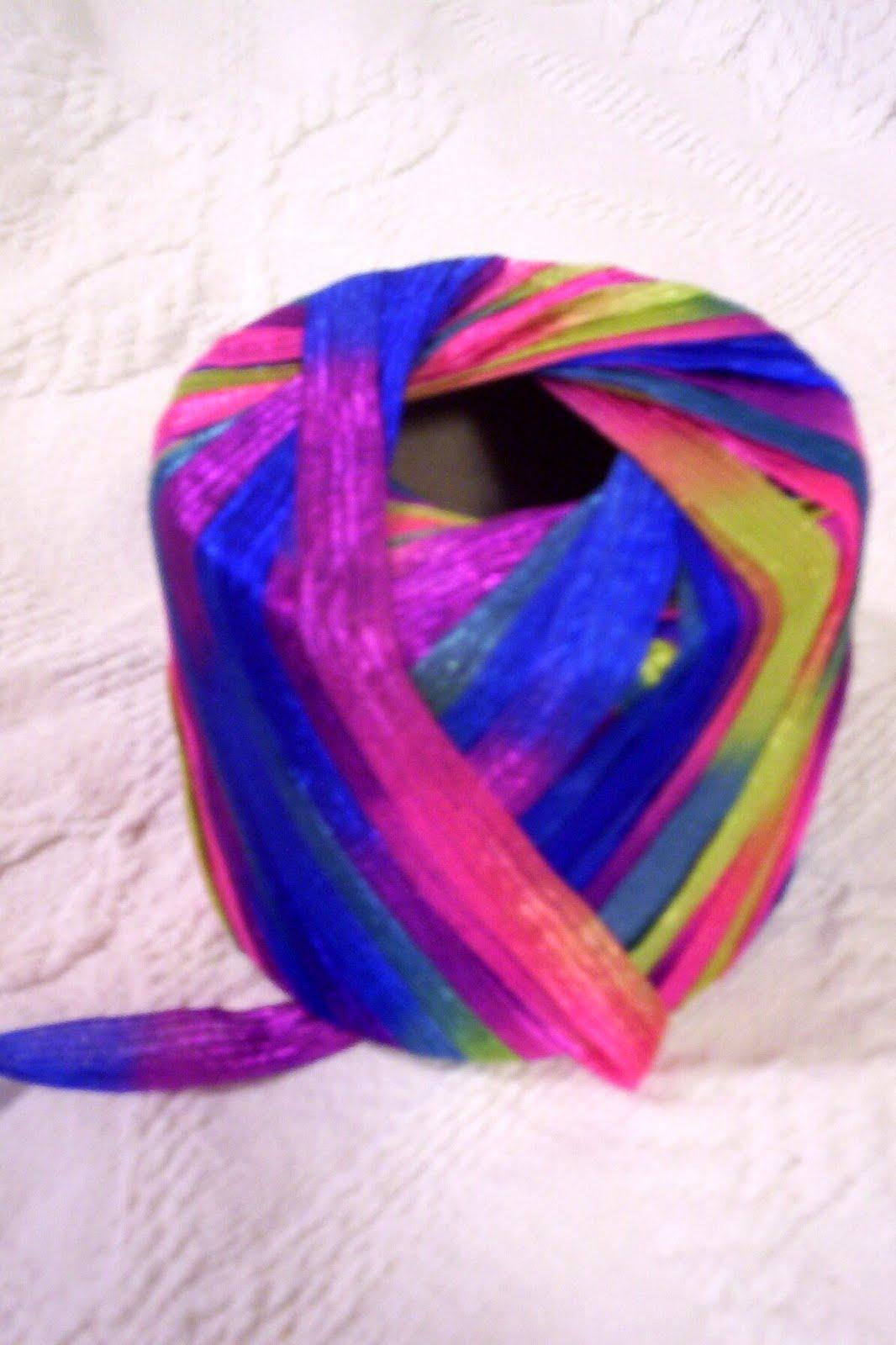 used a flat novelty ribbon yarn, but regular yarn also works]