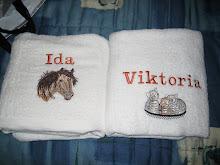 Broderar Handdukar