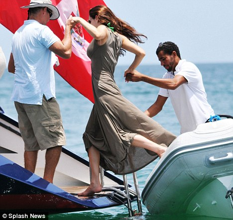 aides kelly is helped onto the boat after getting a