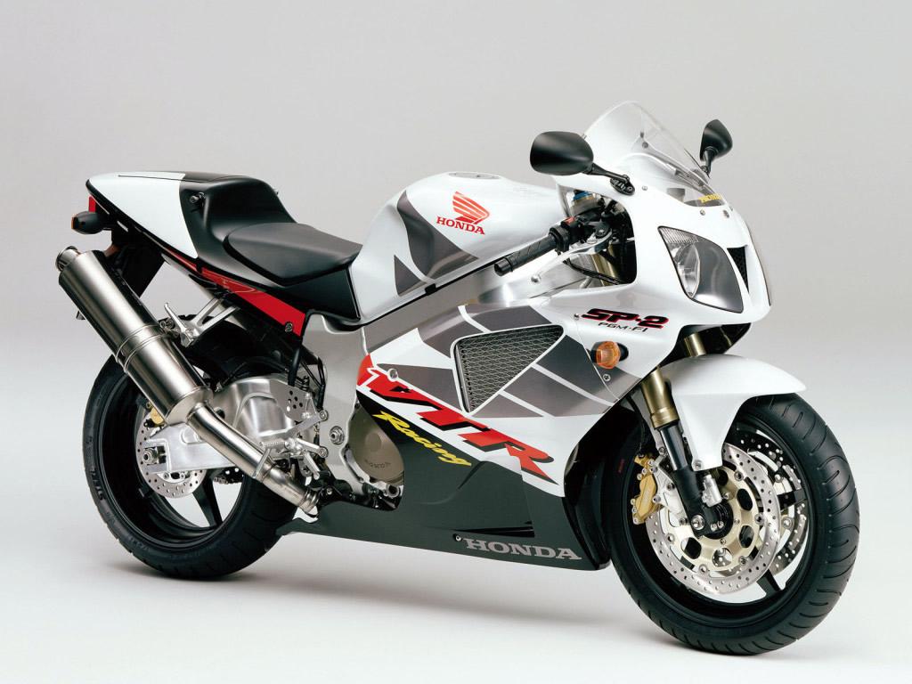 http://1.bp.blogspot.com/_tHtzrWV71cg/TPm-ccMozQI/AAAAAAAAAEc/VfpfGO-YkUw/s1600/honda-sp-2-motorcycle-wallpaper.jpg