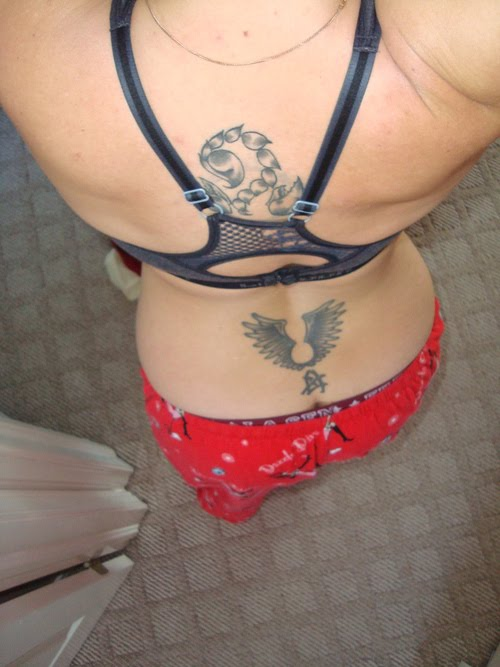 cherub angel tattoos designed with the names of the person's loved one.