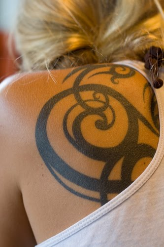 tribal tattoos for women on arm