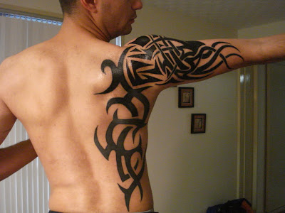 tattoos for guys on arm. Tribal arm tattoos for men are