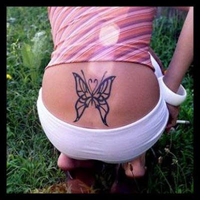 butterfly tattoo on lower back. at 5:20 AM