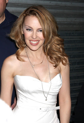 Kylie Minogue Cleavy looks Hot in White Dress hot photo