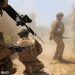 Obama Boosts Troops in Afghanistan with Exit Plan photo