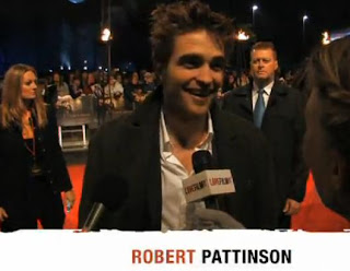Robert Pattinson Interviews At Twilight UK Fan Party Red Carpet