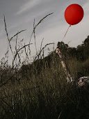 & here it is, a red balloon,