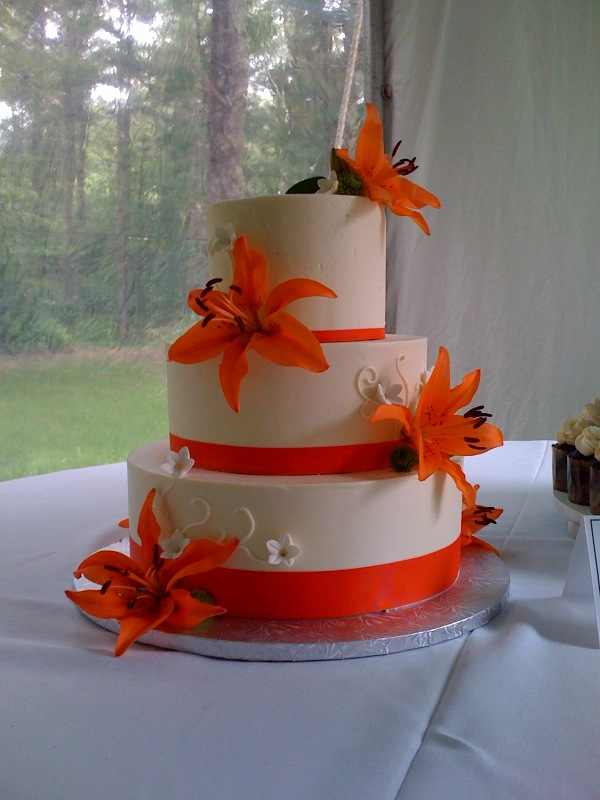 Wedding Cake Buttercream Tiers with Real Lillies and White Scrolls