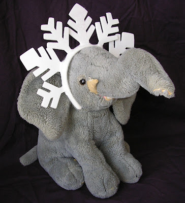 An Act of art and creativity with my stuffed elephant wearing a snowflake headband
