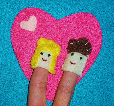 A photography example of my finger puppet crafts showing a girl and a boy in front of a heart
