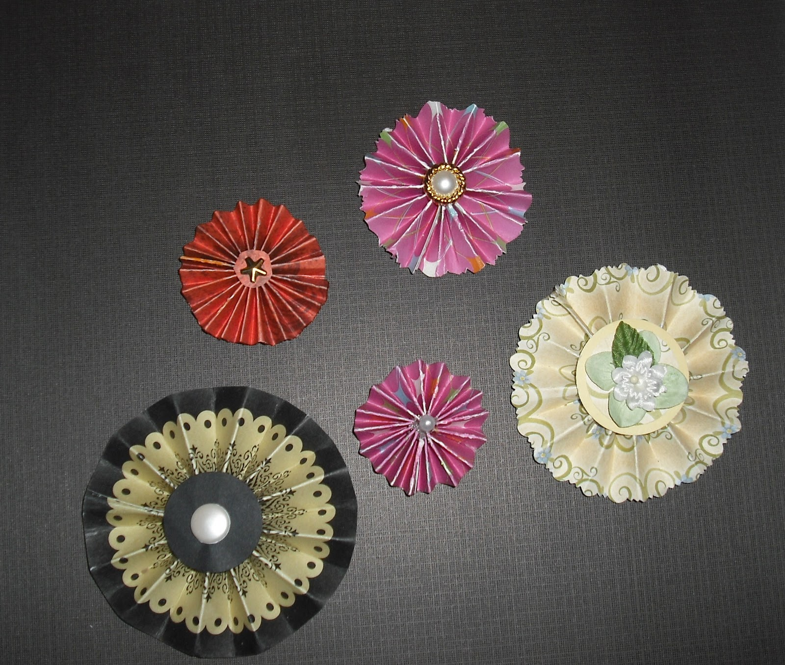 paper rosettes We're always gawking at all the creative backdrops we see at weddings, birthday parties, and other festive events that involve photo booths one thing we've seen over and over again is the paper rosette backdrop it's basically like making a whole bunch of paper fans, stapling them together, and attaching.