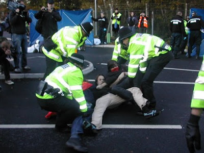 Police manhandling protesters