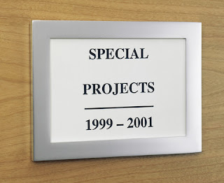aluminim tag holder; label says special projects 1999-2001