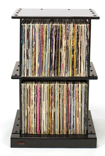 two steel shelves with LPs