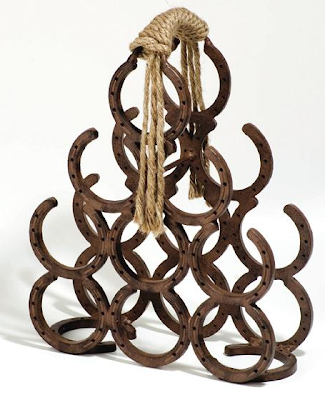 pyrmaid-shaped wine rack made from horseshoes
