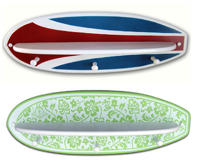 2 surfboard shelves - one with stripes, one with flowers