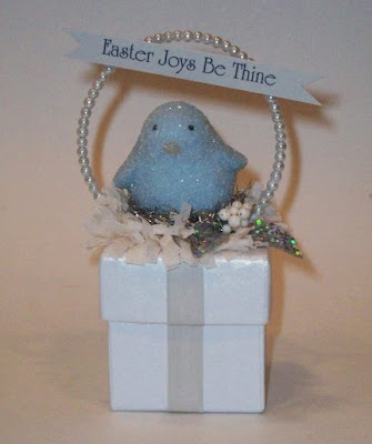 box with bluebird on top, and sign that says Easter joys be thine