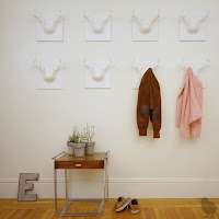 antler-shaped coat rack - white wall with eight of the hangers, also in white