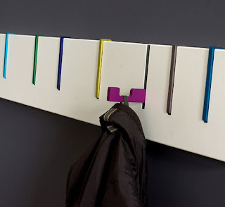 symbol coat rack with hooks that pull down