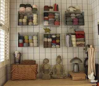 yarn stored in bins on the wall