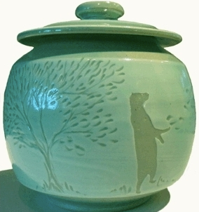 green cookie jar with bear