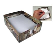 box holding scratch paper