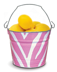 pink and white bucket filled with lemons