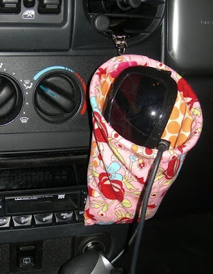 car catch-all, a patterned pouch that attaches to the air vents, etc.