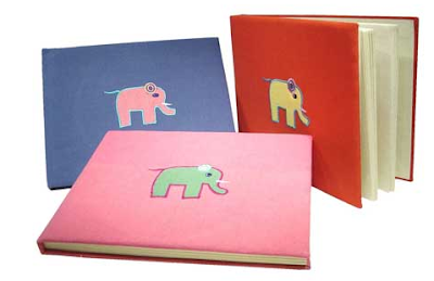 3 photo albums - different colors - with an elephant on the cover of each