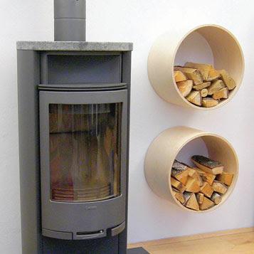 two wall-mounted firewood storage racks, next to fireplace