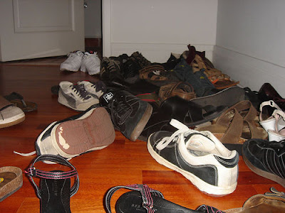Shoes piled up in the
