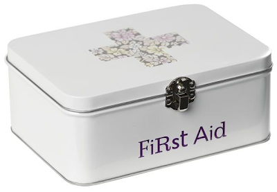 first aid tin with floral cross