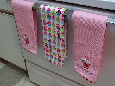 kitchen towels hanging on oven door
